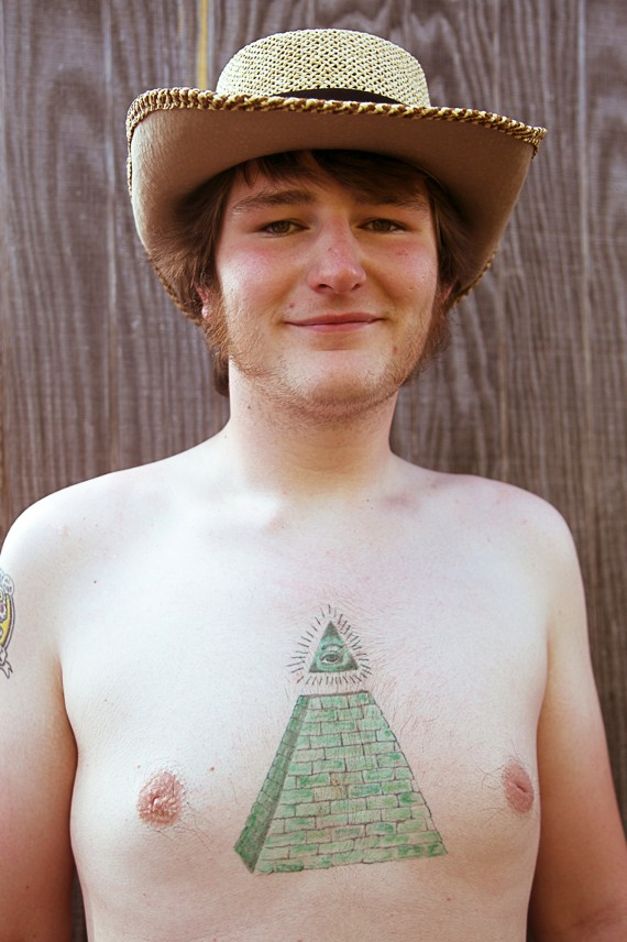 Cowboy hat and tattoo