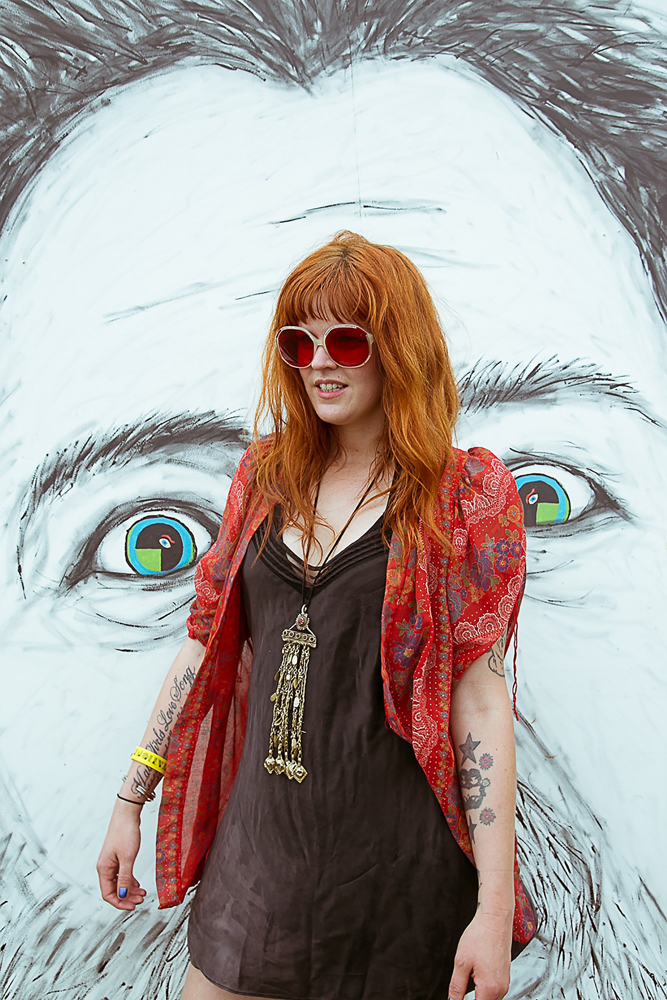 Orange hair and red sunglasses
