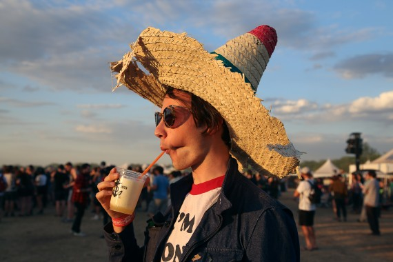 woman in sombrero sipping frozen cocktail
