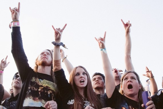 Rock on hand sign held up by a music festival crowd