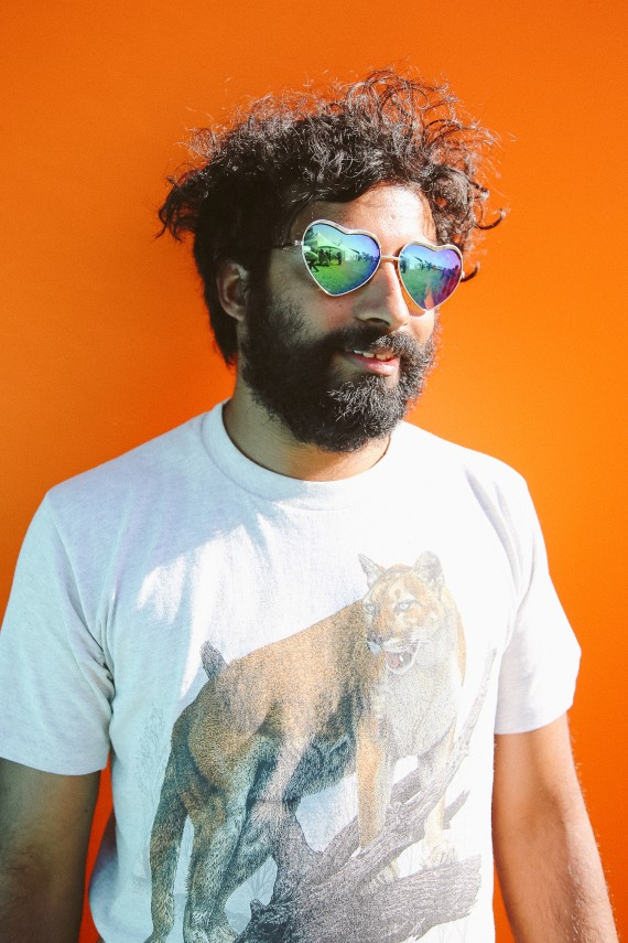 Mirrored Heart Shaped Sunglasses on bearded man with a tiger tee on