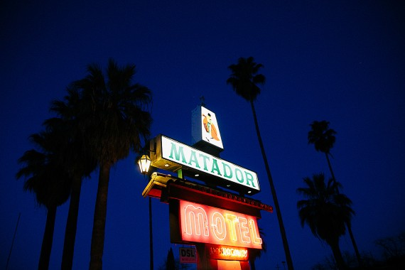 Lit Up Motel Sign at Night