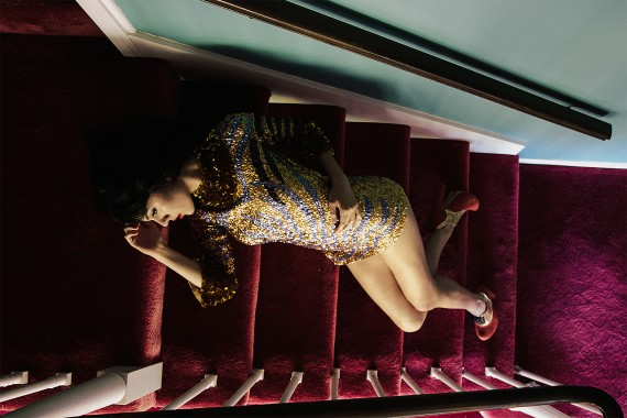 vintage Woman in gold dress laying on a red carpet staircase fashion model shoot photography photograph