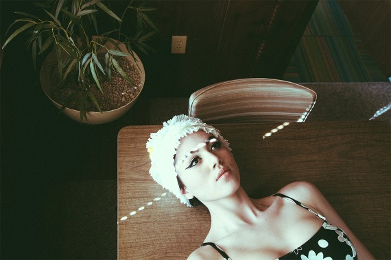 Lace hat on woman laying on wooden table fashion shoot model jackie lee young california texas