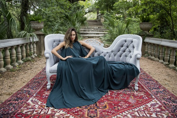 Woman Sitting on a love seat outside on persian area rug