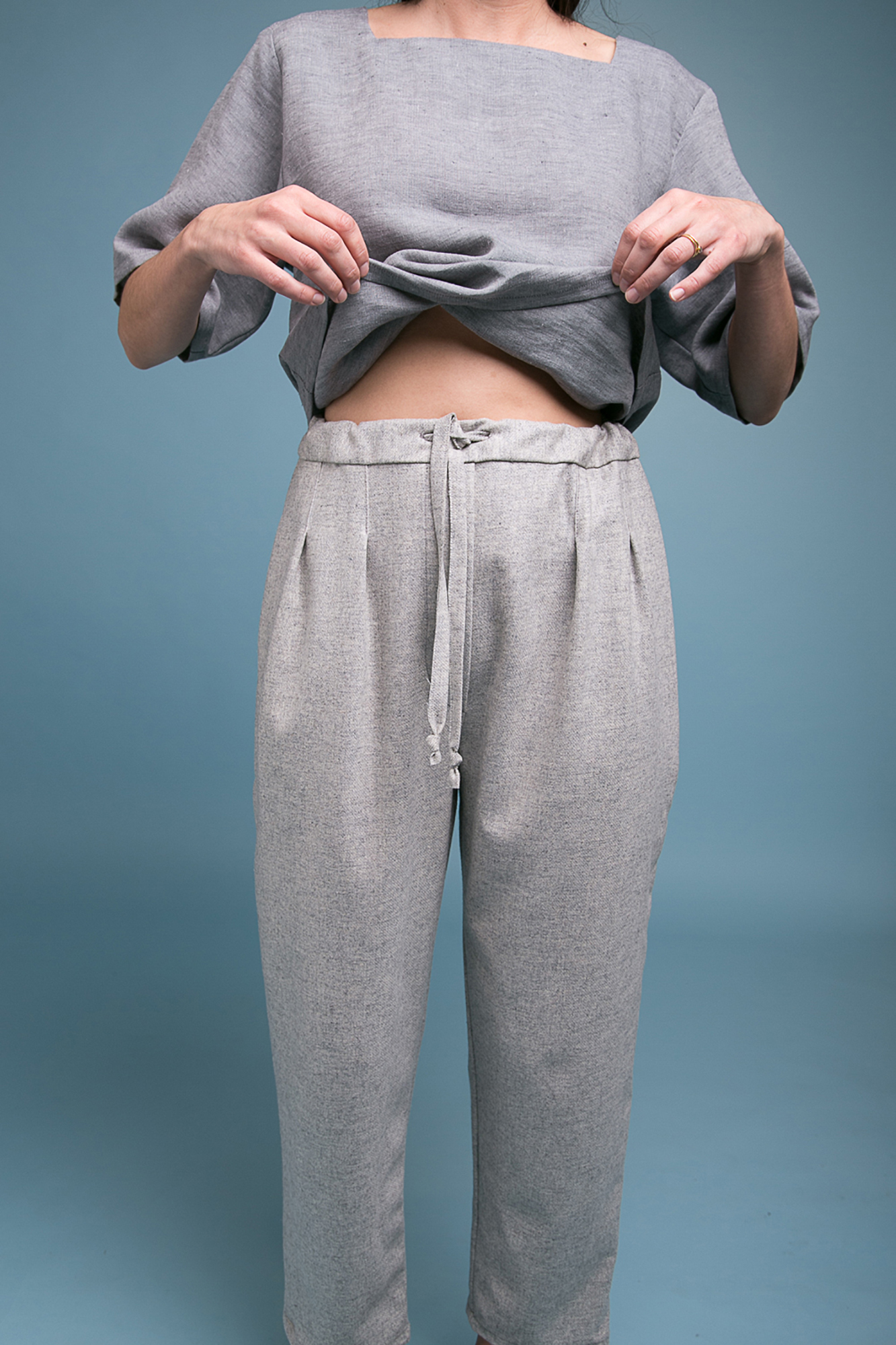 Grey Sweatpants on female model simple sweater