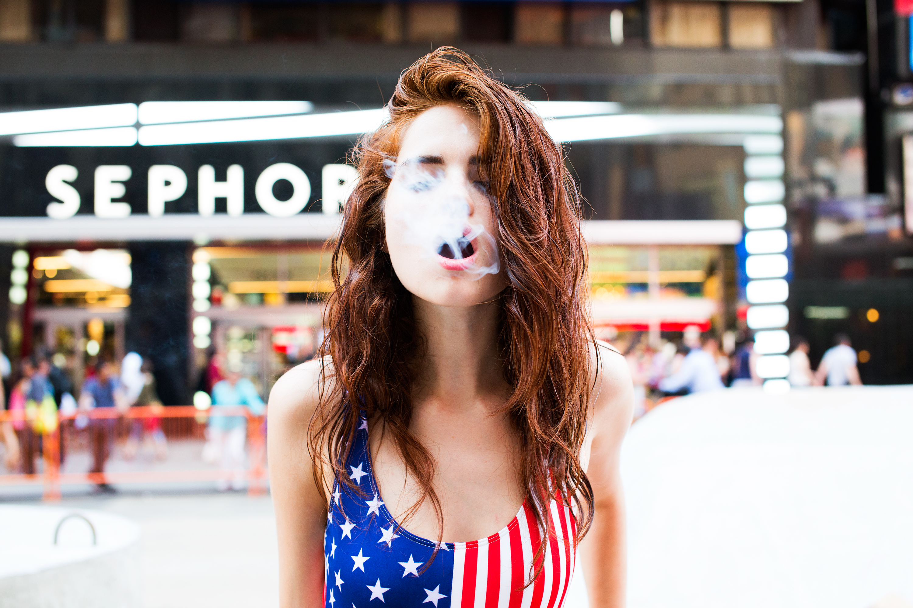 girl blowing smoke