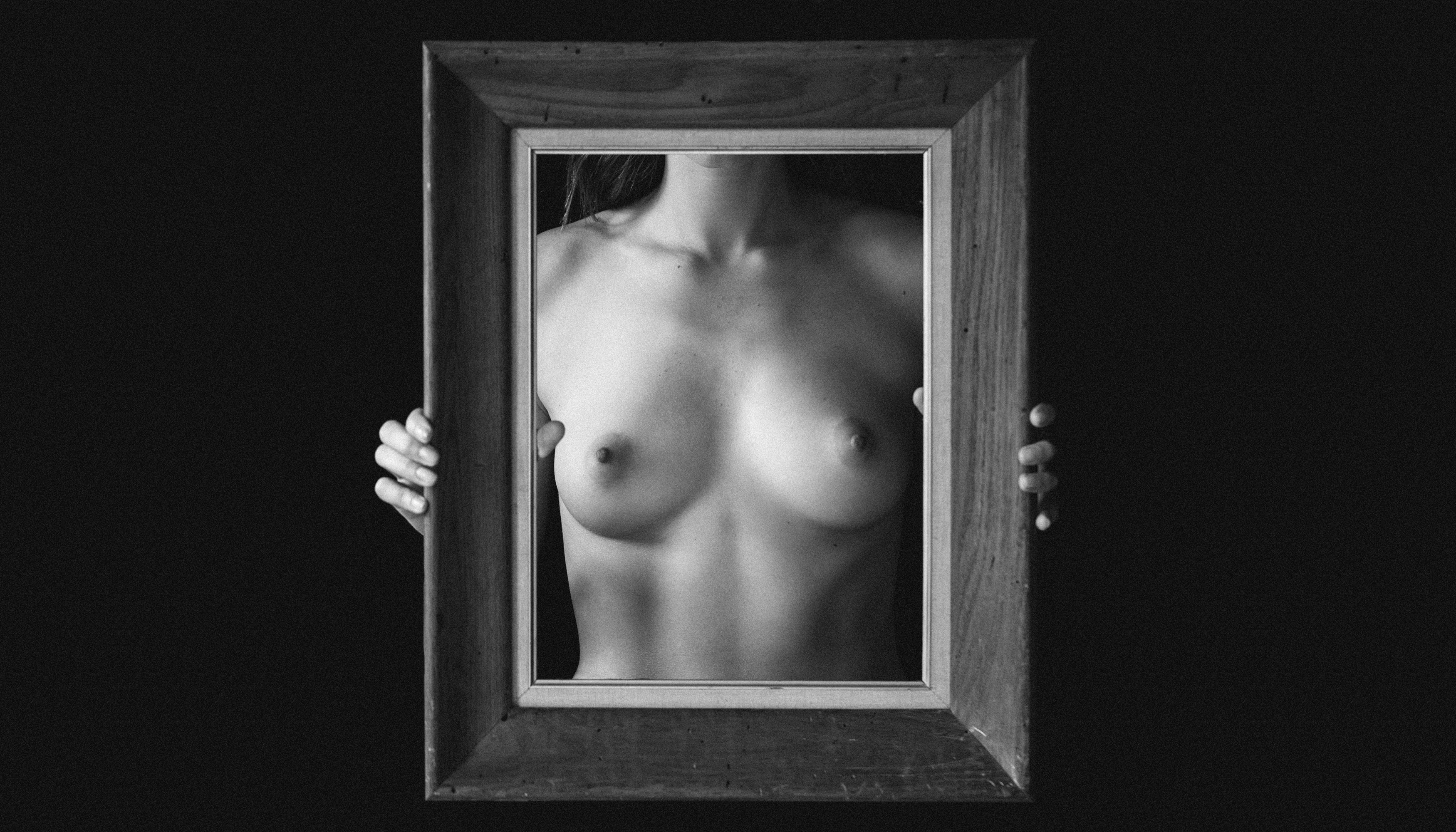 Woman holding up picture frame