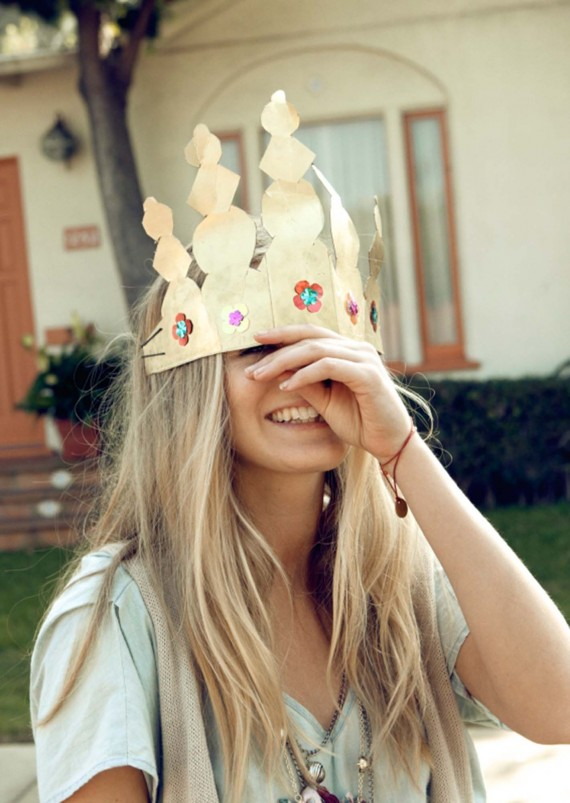 Girl with a paper crown on her head