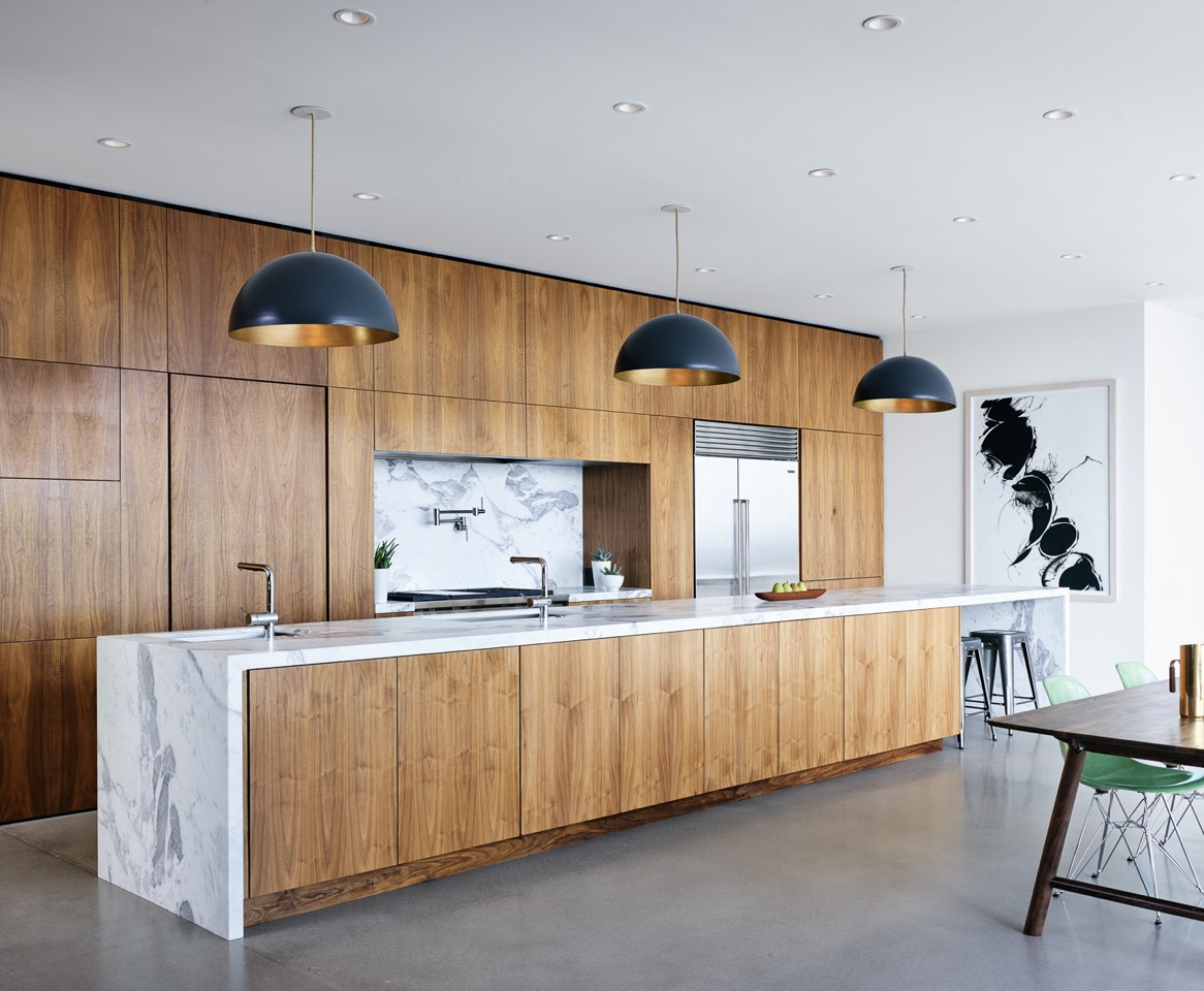 angle view of kitchen with marble counter top